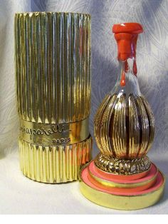Elsa Schiaparelli perfume Si launched in 1957 Made in France. Presented as a gilding and enameled Chianti wine bottle, with Si molded into the top of the faux wax stopper. The gold corrugated box is a spectacular compliment to the bottle. Antique Perfume Bottles, Vintage Bottles, Chianti Wine, Elsa Schiaparelli, Beautiful Perfume, Perfume Collection, Glass Art, Vanities, Corrugated Box