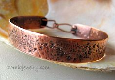 This great looking rustic copper cuff has lots of texture. It was cut from copper sheet and forged into this weathered, earthy design. A patina has been added to bring out the textures in the metal.