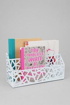 Geo Cutout Letter Storage Bin. A nifty device that stores letters and mail and other bulky items at the door. Love the design as well!