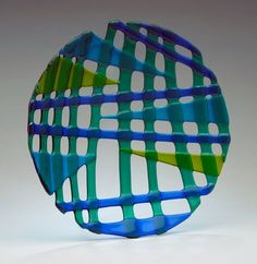 Like a woven basket, strips of blues and greens combine to form a beautiful fused art glass platter. Can be used to hold food such as fruit, or for display .