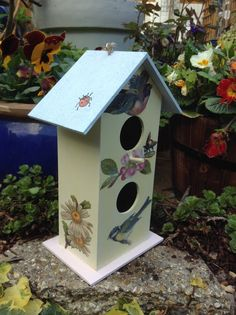 Painted and decoupaged bird house