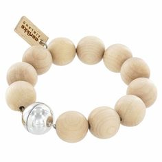 Beautiful wooden beads left in their natural, raw hue. The silver bead is actually a magnetic closure for an easy and comfortable wear. aarikko Natural Wood Ilmatar Bracelet.