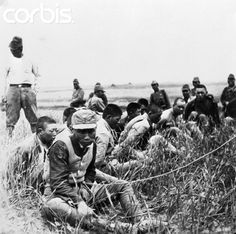 """Nanjing Executions - 42-18233192 - Rights Managed - Stock Photo - Corbis. In order to discourage the Chinese defenders, Japanese Army officials are said to have ordered the execution of all prisoners taken. The war in the Orient is now a war of """"no quarter."""" Here are some Chinese captives patiently waiting death at the execution ground where they will be killed by their Japanese captors. August 25, 1938"""