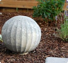 DIY concrete garden spheres using glass light fixtures - get old ones from thrift stores, fill with concrete and then break glass. Color concrete, paint or leave natural.