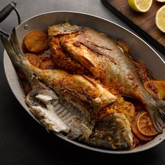 Whole Black Bream with Spiced Pine Nuts + Rice Stuffing over Roasted Potatoes #ottolenghi