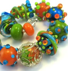 Rome Mini Lampwork Bead Set. $48.00, via Etsy.  (Could use beads & sequins on felted beads to approximate this look.)
