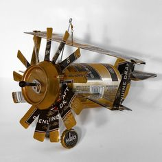 Miller Genuine Draft Airplane now featured on Fab.This handcrafted model biplane by PopCan Aviation was been built from an old aluminum can, and even features a propeller that spins. The pattern was handed down through three generations, after the original artist significantly altered a beer can plane he bought at a fair, crafting it into a beautiful piece of art to enjoy for years to come.