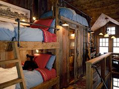Rustic bunkroom. Great use of narrow space, and there is a bathroom under that top bunk....which I am sure every kid will fight to sleep there!