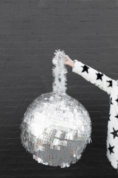 Make a DIY disco ball piñata for your New Year's Eve party with this easy project.