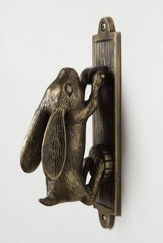Swinging Hare Door Knocker eclectic knobs Make me think of the hasting rabbit in 'Alice in Wonderland'