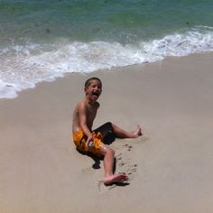Hunter acting silly on the beach.