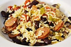 Ingredients: 3 cups cooked rice 1 lb. smoked sausage, sliced 1 (15 oz.) can diced tomatoes 1 can dark red kidney beans, drained chopped onion and bell pepper 2 Tbs