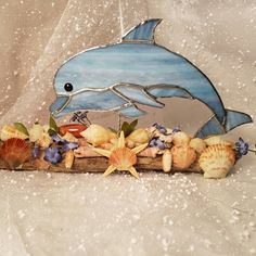 Dolphin leaping over shell island.  Made with driftwood and seashells from Santa Rosa Island Florida.