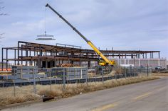 Steel structure portion  is nearing completion, Dec 15, 2017. Crane is sitting near the future front entrance of the Wichita Library.