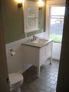 Full bathroom remodel. Cabinet, tile and wainscot built to enhance home's Craftsman style, and original medicine cabinet. Bath (not pictured) tiled with subway tiles. Phinney Ridge