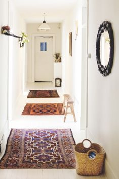 Long hallway? Don't feel like you need one huge runner. Smaller rugs do the trick and help break up the space.