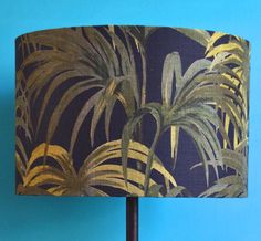A striking drum lampshade made with House of Hackney's Palmeral fabric, an  exotic tropical palm