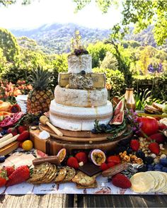 Tiered cake made of cheese wheels. Ultimate magical summer celebration platter, fresh fruit, cheese, honey. Love the natural outside setting! Taken from Your platter Matters on Facebook