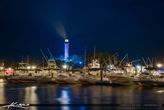 The Jupiter Lighthouse lit up in blue for Autism Awareness. Taken along  the waterway in Jupiter Marina after sunset.