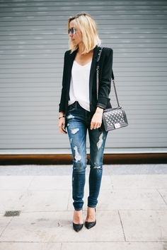 Jacey Duprie is wearing a distressed denim jeans from Express, bag from Chanel, sunglasses from RayBan, shoes from Prada and the blazer is from Helmut Lang
