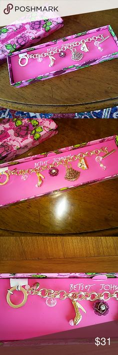 BETSEY JOHNSON CHARM BRACELET! NWT. IN A BEAUTIFUL FLOWERY, PINK BETSEY BOX READY FOR GIFT GIVING! AN ADORABLE GOLDTONE CHARM BRACELET! VERY GIRLY! HIGH HEEL SHOE, FLOWER, DRESS, TIARA BLING! JUST GORGEOUS! Betsey Johnson Jewelry Bracelets
