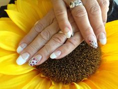 Acrylic nails with white tips ,freehand nail art with swarofski crystals on ring fingers