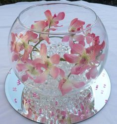 artificial orchids in a simple glass fish bowl but add a candle and pink and clear diamond confetti Fishbowl Centerpiece, Candle Centerpieces, Floral Centerpieces, Wedding Centerpieces, Wedding Table, Floral Arrangements, Wedding Decorations, Table Decorations, Glass Fish Bowl