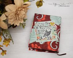 """The back of my Journaling Bible custom Bible Cover that I sewed up tonight using Riley blake fabric and the squares are from Quilting Treasures! Sewing is """"sew"""" fun!"""