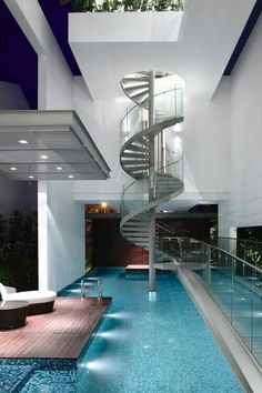 Love the spiral staircase | wainscotingamerica.com #staircase #wainscoting #design #craftsman A staircase from the pool to a roof patio would be amazing