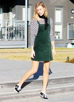 The Fashion Eaters layers a green suede dress over a striped shirt and sneakers