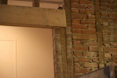 The remaining drywall came down exposing more crumbling red bricks, plaster and lathe.