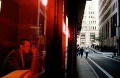 Characters bathed in coloured light to reduce the palette to simple and more direct monochromes - photo by Alex Webb