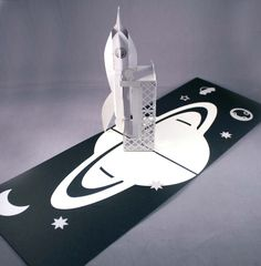 Space age popup silver rocket/planets card.