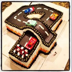 Birthday Racetrack Cake this is awesome! Aiden either wants dinos or race cars for his next birthday. This is pretty cool! Birthday Racetrack Cake this is awesome! Aiden either wants dinos or race cars for his next birthday. This is pretty cool! 4th Birthday Cakes, Fourth Birthday, Car Birthday, Happy Birthday, Fancy Cakes, Cute Cakes, Race Car Cakes, Car Cakes For Boys, Number Cakes