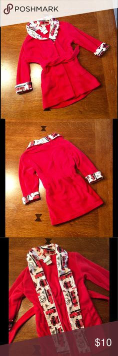 Boys fire truck robe. Cute boys fire truck robe in size 2T.  Designed by Bunz Kidz.  100% polyester.  Two front pockets.  Slightly gathered waist with tie.  Top of shoulder to bottom measures 21 in.  Sleeve measures 12 in.  Robe has been worn 1-2 times but is in excellent condition. Bunz Kidz Other