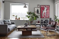 Livingroom with rusty and grey colours. Walls painted in the color Södermannagatan from Alcro.