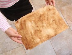 Every summer crafting experience should include making some faux parchment paper, don't you think? And we're here to help you! We, meaning me, the photographer, and my almost 11 year old daughter, the crafter! See this roll of parchment paper,that...