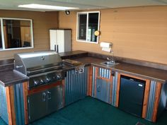 Complete outdoor kitchen by Sunset Outdoor Living, LLC.  Wood & corrugated metal with stainless steel appliances! call us for your custom quote - 503-831-4677