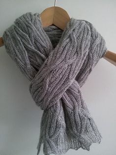 This luxurious rectangular wrap is based on a simple k2, p2 rib, with ribbed cables used to create a woven texture. The wrap is fully reversable with no right side. Knitted in baby alpaca laceweight it is light and warm, and can be worn as a wrap or a scarf.