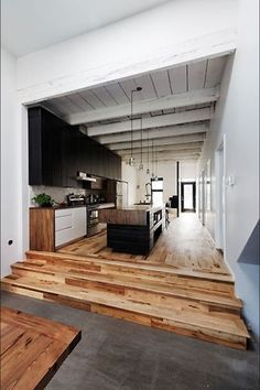 modern hall with black doors and art and horizontal medium wood plank hardwood floors space. Black Bedroom Furniture Sets. Home Design Ideas