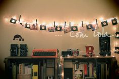 decor –cute bedroom decorated with Christmas lights used to hang photographs!