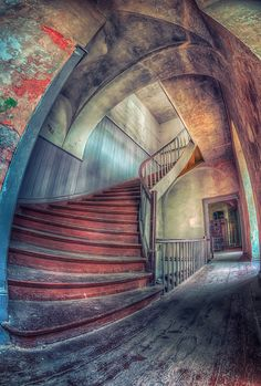 Staircase in an abandoned palace in Poland.  Neat photo!
