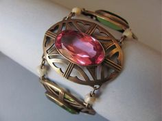 An Art Nouveau Jugendstil glass and pearl bracelet. ~ The pink sapphire represents resilience and wisdom learned by having lived through difficult and often painful times.