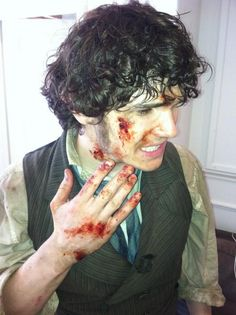 Fra Fee, fully made-up on the set of Les Mis.