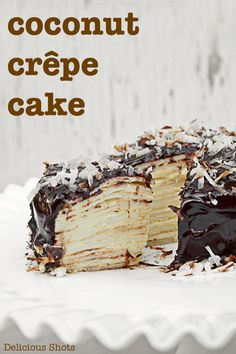 Coconut Crepe Cake via Delicious Shots, layers of crepe filled with coconut cream covered in chocolate and shredded coconut, drool! Coconut Desserts, Just Desserts, Delicious Desserts, Yummy Food, Tasty, Crepes, Yummy Treats, Sweet Treats, Cake Recipes