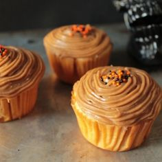 Spiced cupcake filled with pumpkin cream and topped with caramel frosting. Happy Halloween!