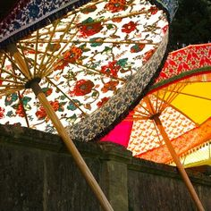 These colourful parasols are handmade in cornwall by artists Charlie and Katie Napier. Made from either vintage or designer fabrics that have been treated to make them waterproof, each parasol is unique,