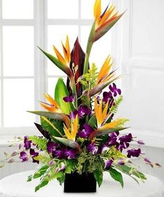 Image result for large flower arrangement with bird of paradise