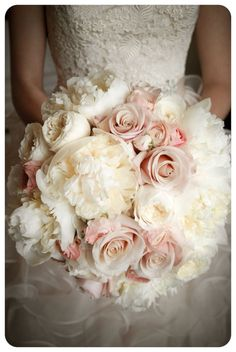 A romantic bouquet of white peonies, white garden roses, mother of pearl roses and blush pink ranuculas. How beautiful! Thank you Meghan, June 8, 2013.