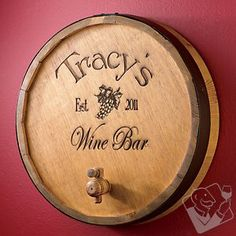 Distinctive decor, from the winery to your wall. This personalized oak wine barrel top sign is cut from an oak wine barrel with steel hoop and spigot still intact: $99.95